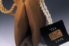 "Tea Bag, 2002, 7""x3""x7"", wool, reed, stitched."